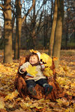 Little boy in a chair outdoors Stock Image