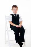 Little boy in the chair with pencils and books Royalty Free Stock Photo
