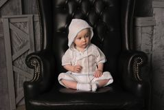 Little boy in chair Royalty Free Stock Images
