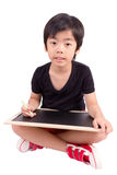 Little boy with chalk on a blackboard Stock Photography