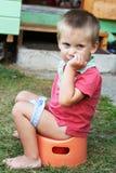 Little boy on chamber pot Stock Photos