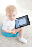 Little boy on the chamder with tablet pc Stock Images