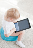 Little boy on the chamder with tablet pc Royalty Free Stock Image