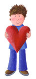 Little Boy che tiene Valentine Heart Immagine Stock Libera da Diritti