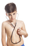 Little boy check his heart by stethoscope Stock Photo