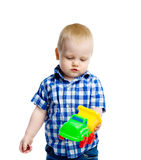 Little boy in checkered shirt plays with a toy car Royalty Free Stock Image