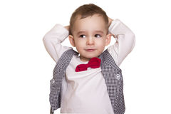 Little boy in a checkered suit and bow tie holding his head Stock Images
