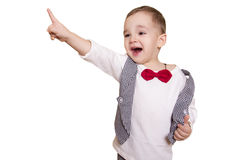 Little boy in a checkered suit and bow tie shows thumb up Royalty Free Stock Photos