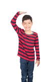 Little boy checking his height on white background Royalty Free Stock Photography