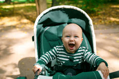 Little boy cheerfully laughs Stock Image