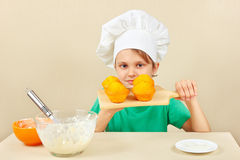 Little boy in chef hat with a cooked appetizing cake Royalty Free Stock Photo