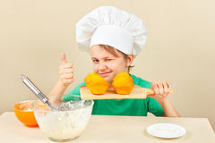 Little boy in chef hat with cooked the appetizing muffin Royalty Free Stock Image