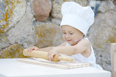 Little boy with chef hat cooking Royalty Free Stock Image
