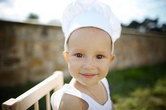 Little boy with chef hat cooking Stock Photos