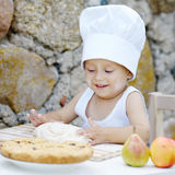 Little boy with chef hat cooking Royalty Free Stock Images