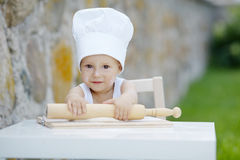 Little boy with chef hat cooking Royalty Free Stock Photography