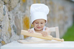 Little boy with chef hat cooking Royalty Free Stock Photos