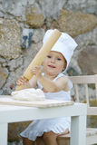 Little boy with chef hat cooking Stock Photography