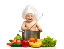 Little boy in chef's hat Stock Images