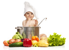 Little boy in chef's hat sitting in large casserole Royalty Free Stock Image