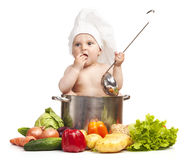 Little boy in chef's hat sitting in large casserole Stock Images