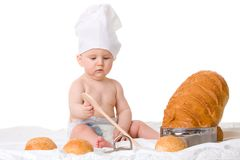 Little boy chef with spoon Stock Image