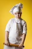 Little boy chef in uniform Stock Photos
