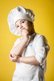 Little boy chef in uniform Royalty Free Stock Image