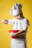 Little boy chef in uniform Stock Image