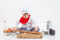 Little boy with chefs hat Stock Image