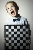 Little boy with chessboard.Chess.Emotion.Scream child Stock Photography