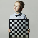 Little boy with chessboard.Little genius Child Stock Photography