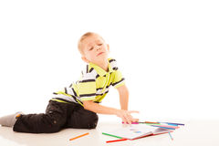 Little boy child drawing with color pencils Royalty Free Stock Photos