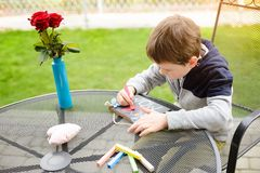 Little boy child drawing a love declaration Stock Image