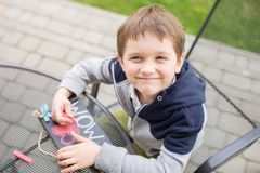 Little boy child drawing a love declaration Stock Photos