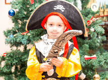 Little boy child dressed as pirate for Halloween  on background of Christmas tree Stock Photo