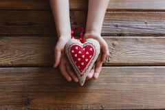 Little boy child hands holding gift for mother. On Mother`s Day Stock Photo