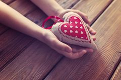 Little boy child hands holding gift for mother. On Mother`s Day Stock Photos