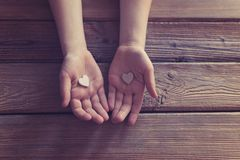 Little boy child hands holding gift for mother. On Mother`s Day Royalty Free Stock Images