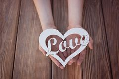 Little boy child hands holding gift for mother. On Mother`s Day Royalty Free Stock Photography