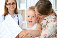 Little boy child  with his mother  after health exam at doctor`s office Stock Image