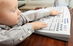 Little boy child kid playing on the computer Royalty Free Stock Images