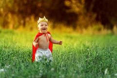 Little boy child king laughs. The little boy, the child king is laughing on a summer evening royalty free stock photos