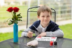 Little boy child painting greeting card for his mother Stock Images