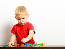 Little boy child playing with building blocks toys interior. Stock Images