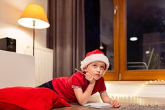 Little boy child preparing wish list Royalty Free Stock Photography