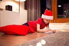 Little boy child preparing wish list Stock Images