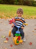 Little boy on a children's bicycle Stock Images