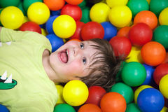 Little boy in the children's playground Stock Images
