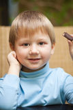 Little boy with chocolate candy Royalty Free Stock Images